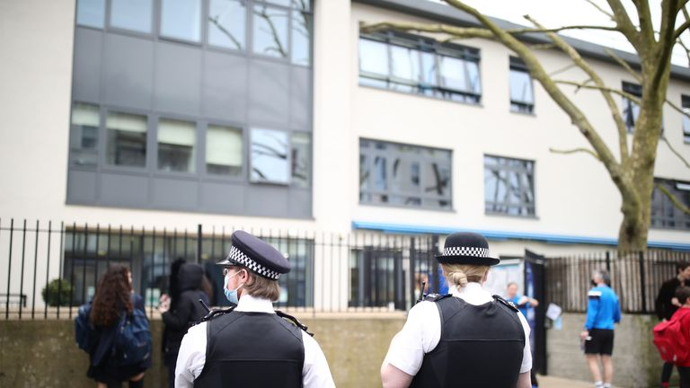 Police officers outside Pimlico Academy School, west London, where students have staged a walkout in protest over a school uniform policy that they claim is discriminatory and racist. Picture date: Wednesday March 31, 2021.