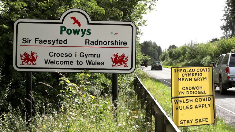 A car drives past the Wales border line between Wales and England following the easing of coronavirus lockdown restrictions across England.