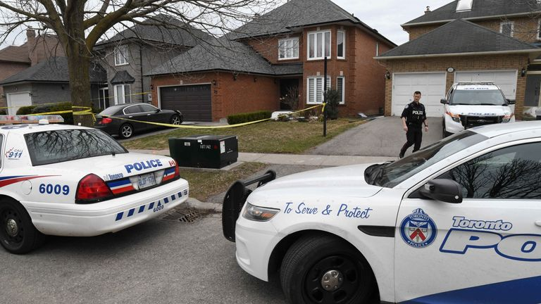 Police vehicles are parked in front of the home of Alek Minassian, a day after multiple people were struck along a major intersection northern Toronto, Ontario, Canada, April 24, 2018