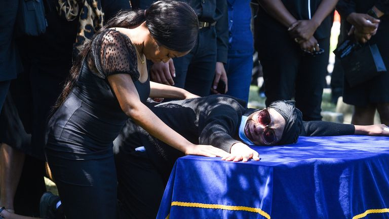 Alexander Kareem's sister Khafi (left) and mother Victoria during his burial in July
