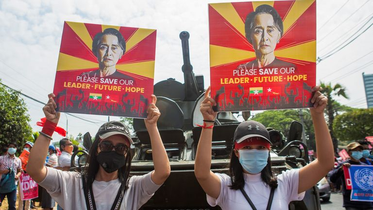 Demonstrators hold placards with the image of Aung San Suu Kyi during a protest against the military coup, outside the Central Bank of Myanmar in Yangon, Myanmar, February 15, 2021. REUTERS/Stringer NO RESALES. NO ARCHIVES