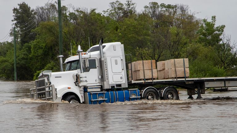 A truck drives through a flooded road at Old Pitt Town north west of Sydney. Pic: AP