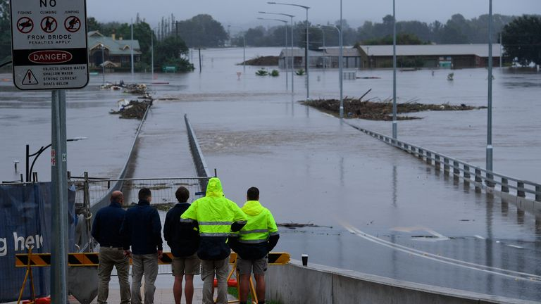 The New Windsor Bridge is seen inundated by flood waters from the Hawkesbury River at Windsor in the north west of Sydney