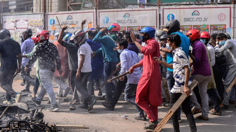 Violence erupted in Dhaka after one group of protesters began waving their shoes as a sign of disrespect to Indian Prime Minister Narendra Modi, and another group tried to stop them, witnesses said