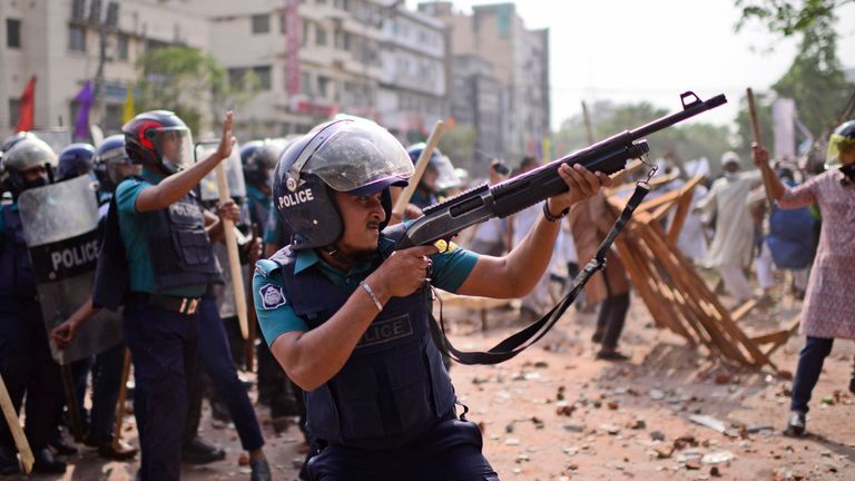 Security officers clashed with protesters in Dhaka