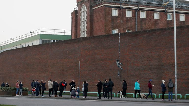 A suspected new mural by artist Banksy is seen on a wall at HM Reading Prison