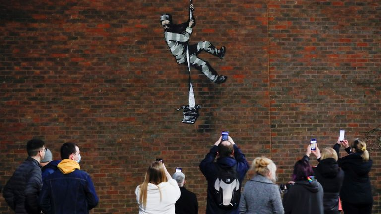 A suspected new mural by artist Banksy is seen on a wall at HM Reading Prison in Reading