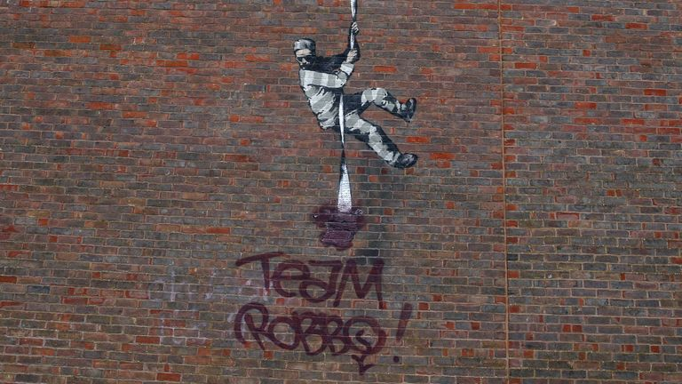 The artwork by Banksy was defaced with the words 'team Robbo'