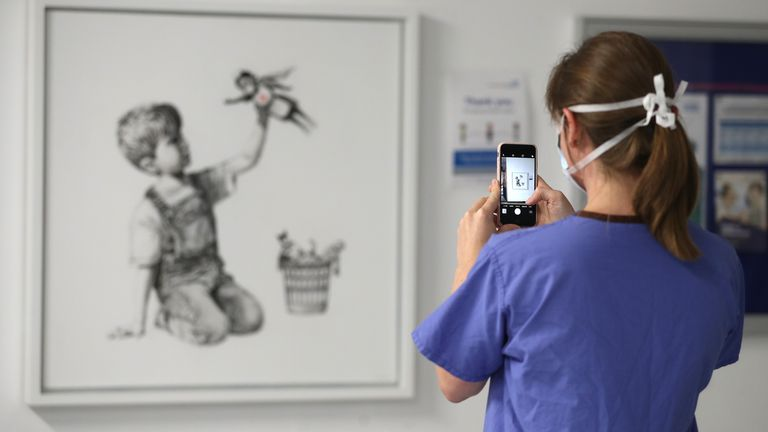 Banksy's Game Changer artwork, which appeared at Southampton General Hospital in May 2020, has fetched £16.8 million at auction - a world record for the artist, according to Christie's
