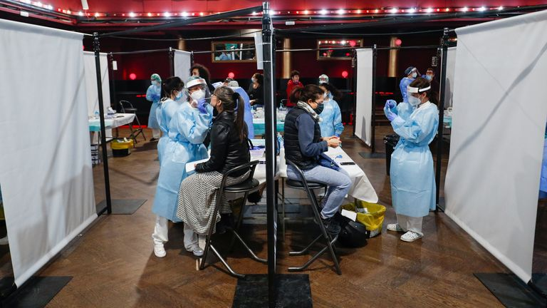 Concert-goers are tested for COVID-19 ahead of a 5,000-strong audience at a concert in Barcelona
