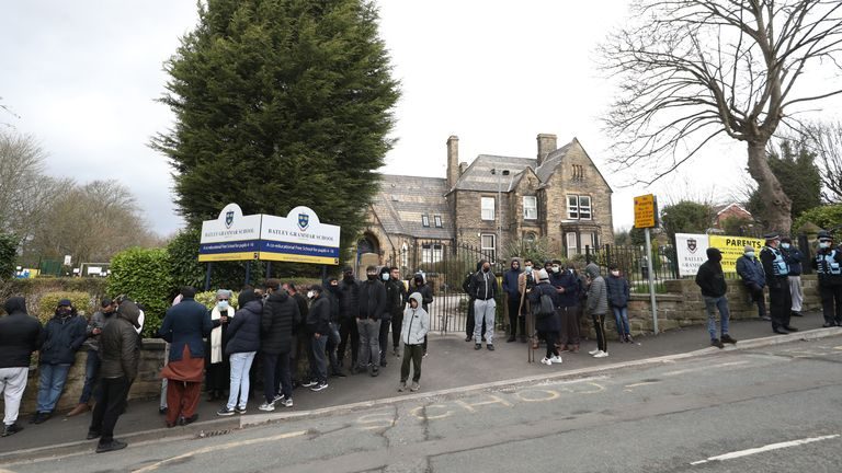 Protesters gathered outside Batley Grammar School in Batley, West Yorkshire, where a teacher has been suspended for reportedly showing a caricature of the Prophet Mohammed to pupils during a religious studies lesson. Picture date: Friday March 26, 2021.