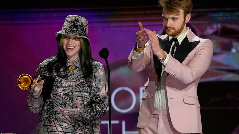Billie Eilish accepts the award for record of the year alongside her brother, Finneas O'Connell. Pic: AP