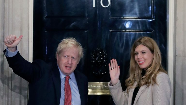 Britain's Prime Minister Boris Johnson and his partner Carrie Symonds wave from the steps of number 10 Downing Street in London, Friday, Dec. 13, 2019. Prime Minister Boris Johnson's Conservative Party has won a solid majority of seats in Britain's Parliament ... a decisive outcome to a Brexit-dominated election that should allow Johnson to fulfill his plan to take the U.K. out of the European Union next month. (AP Photo/Matt Dunham)