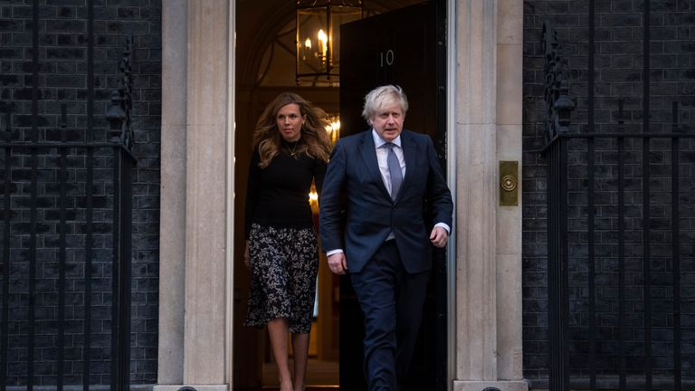 Prime Minister Boris Johnson and Carrie Symonds walk out of Number 10 Downing Street
