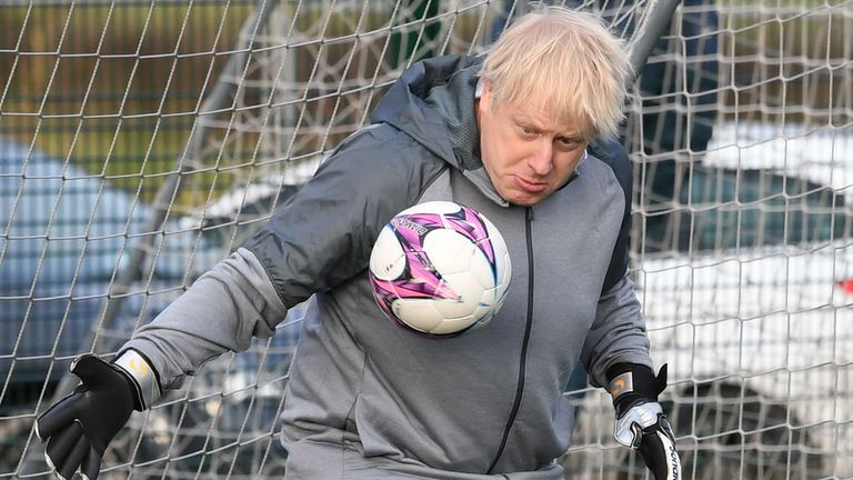 Prime Minister Boris Johnson tries his hand in goal in Cheadle Hume, Cheshire