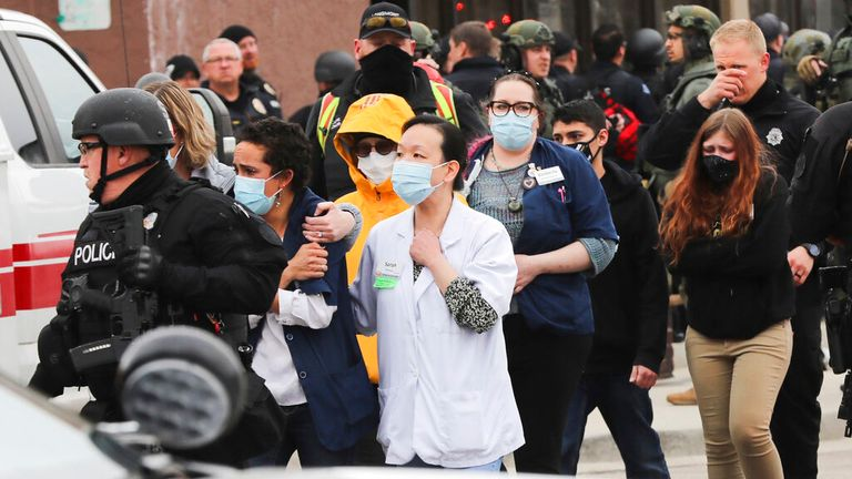 Police lead people out of the supermarket in Boulder, Colorado. Pic: AP