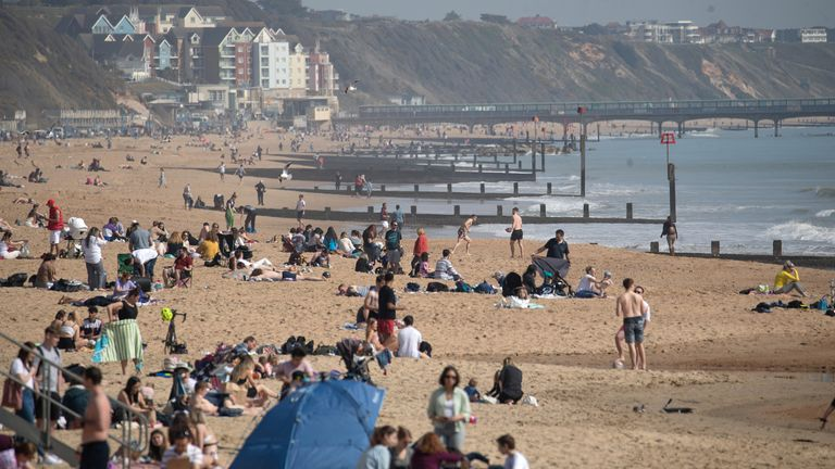 People enjoy the warm weather on Bournemouth beach on Tuesday
