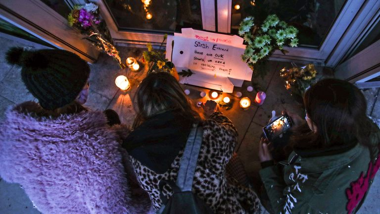 Three women light candles in Bournemouth after the Reclaim These Streets vigil for Sarah Everard was cancelled.