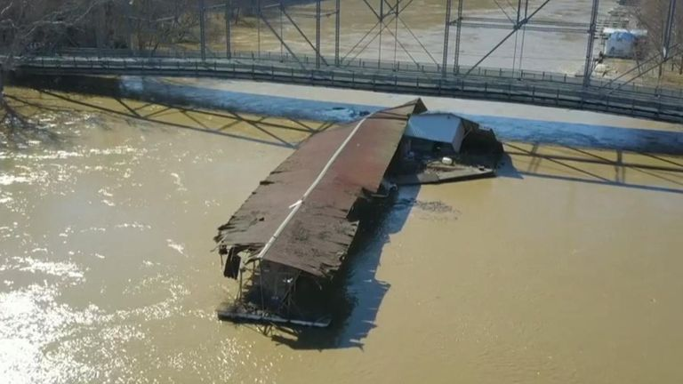 A 200-foot marina that broke loose amid heavy flooding in Kentucky drifted under multiple bridges along the river.