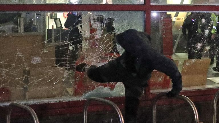 Protester kicks a smashed Bridewell Police Station window, as they take part in a 'Kill the Bill' protest in Bristol, demonstrating against the Government's controversial Police and Crime Bill. Picture date: Sunday March 21, 2021.