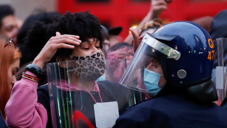 A demonstrator gestures during a protest against a new proposed policing bill