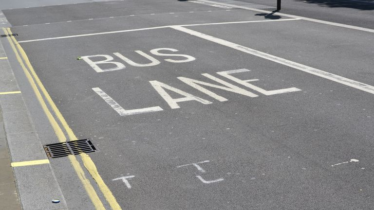 A bus lane road marking