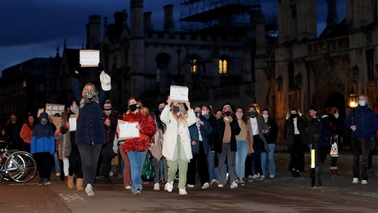 People attend a vigil for Sarah Everard, following her kidnap and murder, at King's Parade street in Cambridge, Britain March 13, 2021. REUTERS/Andrew Boyers