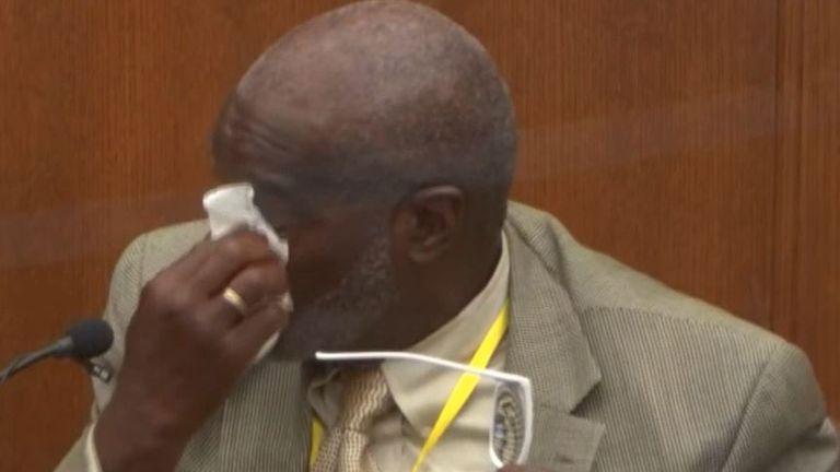 Witness Charles McMillian reacts with tears after viewing evidence