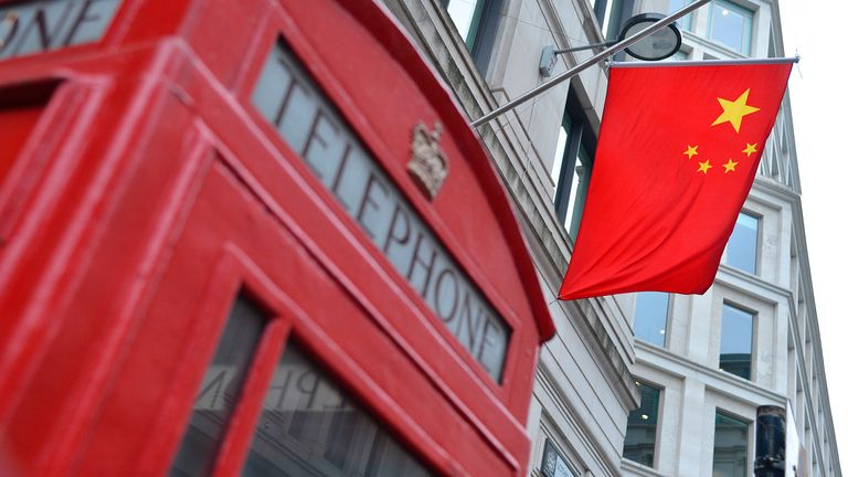 A flag hangs from the Bank of China offices in the City of London March 6, 2013. REUTERS/Toby Melville (BRITAIN - Tags: BUSINESS)