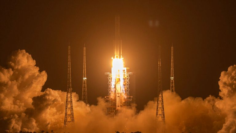 FILE - In this Nov. 24, 2020, file photo, a Long March-5 rocket carrying the Chang'e 5 lunar mission lifts off at the Wenchang Space Launch Center in Wenchang in southern China's Hainan Province. China and Russia said they will build a lunar research station, possibly on the moon's surface, marking the start of a new era in space cooperation between the two countries. (AP Photo/Mark Schiefelbein, File)