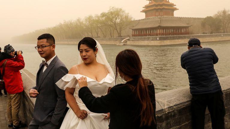 طوفان مانع ازدواج یک زوج در نزدیکی شهر ممنوعه نشده است