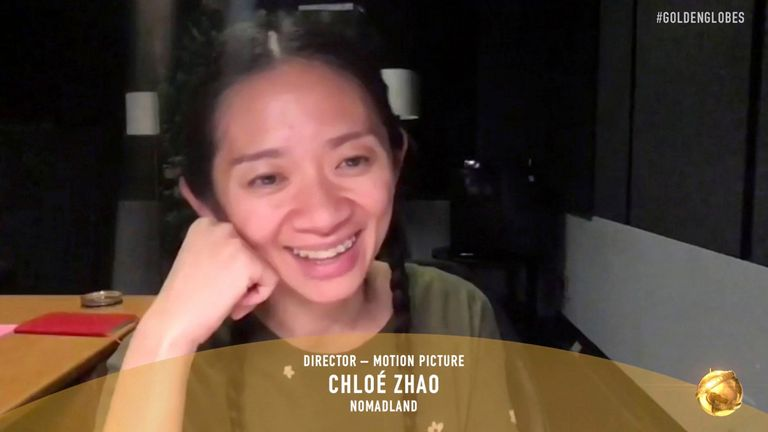 Chloe Zhao accepts the award for best director for a motion picture for Nomadland at the Golden Globes 2021: NBC/AP