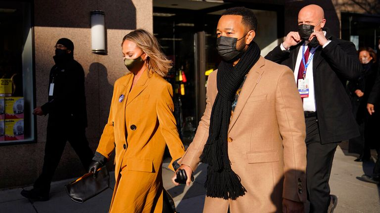 Chrissy Teigen and husband John Legend are pictured leaving for Joe Biden's inauguration in January. Pic: AP