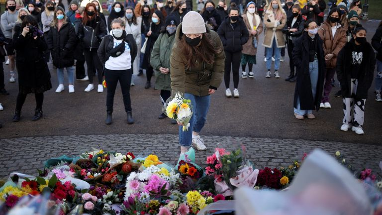 People gather at a memorial site in Clapham Common Bandstand, following the kidnap and murder of Sarah Everard, in London, Britain March 13, 2021. REUTERS/Hannah McKay
