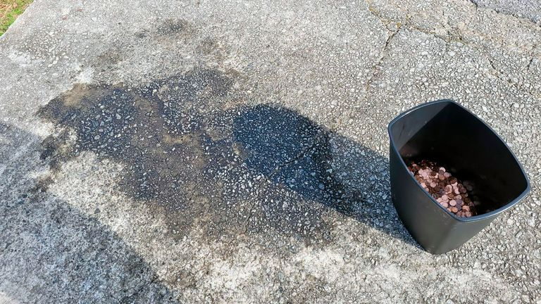 A stain on the drive way where the coins were found. Pic Associated Press