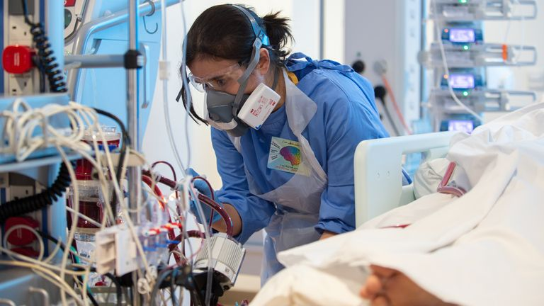 A specialist nurse checks on a COVID-19 patient at the Royal Papworth Hospital, Cambridge