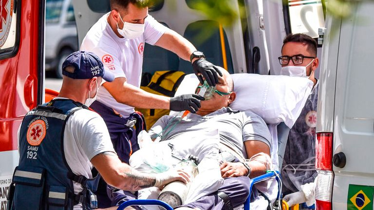 A man with COVID symptoms arrives at a medical facility in Lages, Santa Catarina state. Pic: AP