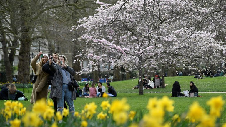 People relax in St. James's Park, ahead of lockdown restrictions being eased, amid the spread of the coronavirus disease (COVID-19) pandemic, London