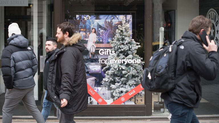 A shop on London's Regent Street displays Christmas decorations in March after having to close in December