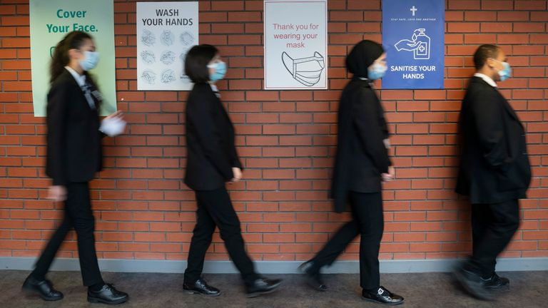 Pupils queue for a socially distanced assembly at a school in Manchester. Pic: AP