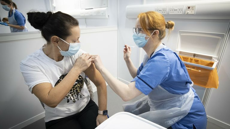 A nurse giving a Covid-19 vaccine