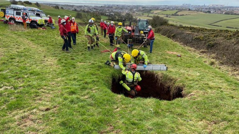 The farmer was rescued after falling into a 60ft (18m) deep sinkhole. Pic: @CumbriaFire