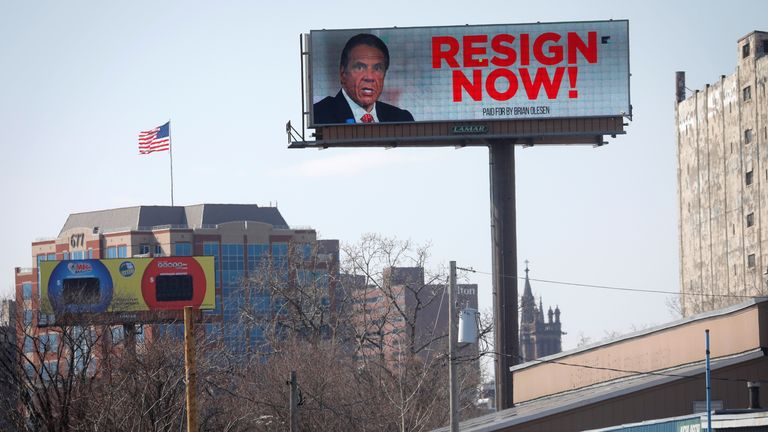 "An electronic billboard displays a message that reads ""Resign Now"" for New York Governor Andrew Cuomo, in the wake of allegations that he sexually harassed young women, in Albany, New York, U.S., March 3, 2021. REUTERS/Mike Segar"