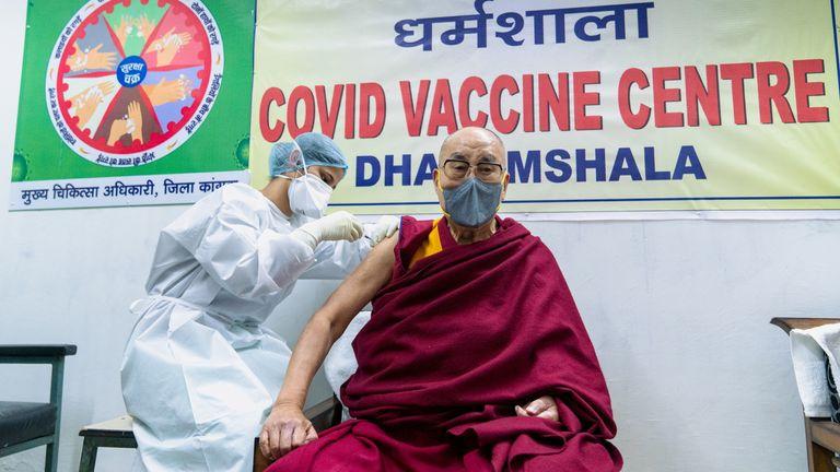 The Dalai Lama has been given his first jab at a hospital