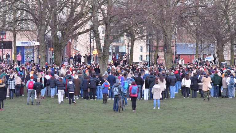 People gather on College Green in Bristol after the Reclaim These Streets vigil for Sarah Everard was officially cancelled.