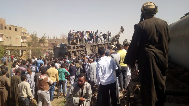 People inspect the damage after two trains have collided near the city of Sohag, Egypt, March 26, 2021. REUTERS/Stringer NO RESALES. NO ARCHIVES