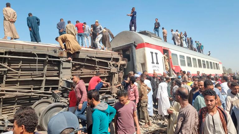 At least 32 people have been killed after two trains collided near the Egyptian city of Sohag, around 300 miles south of Cairo. Pic: Mahmoud Maqboul/picture-alliance/dpa/AP