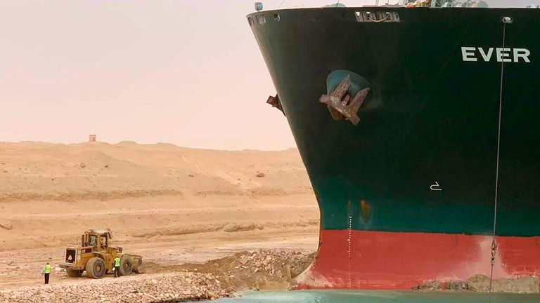 In this photo released by the Suez Canal Authority, a cargo ship, named the Ever Given, sits with its bow stuck into the wall Wednesday, March 24, 2021, after it become wedged across Egypt's Suez Canal and blocked all traffic in the vital waterway. Pic: AP