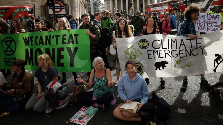 Climate change campaigners in a sit-down protest in London Pic: AP