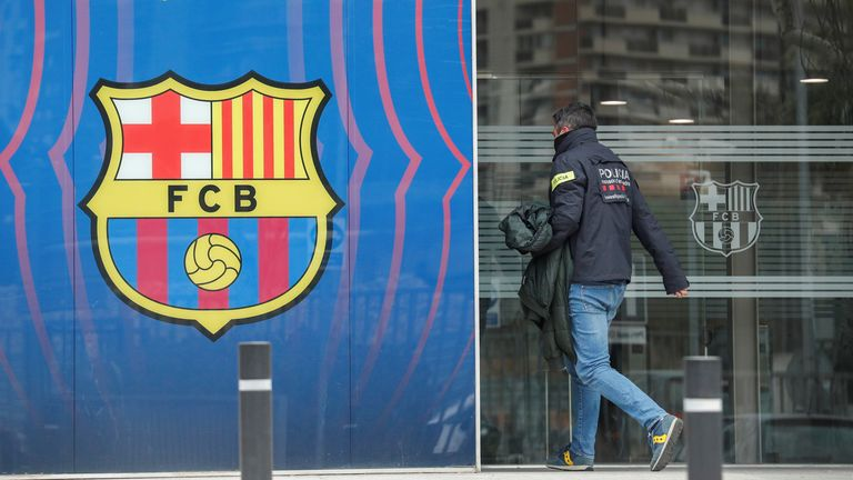 A police officer enters the offices of FC Barcelona